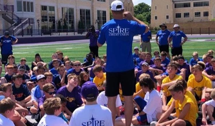 Kirk Cousins talks to kids at football camp
