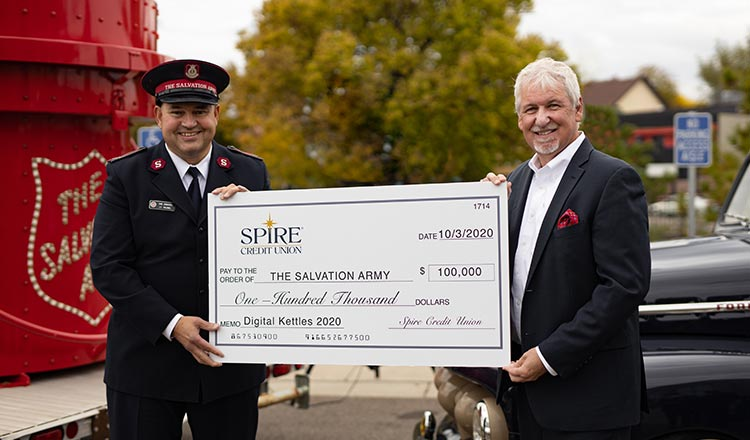 Dan Stoltz handing check for $100,000 to Salvation Army representative